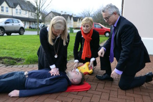 Mary O'Connor, Beaufort, illustrates how to perform CPR on colleague Damian Baker as Dr John Geaney and Dr Fiona Gallagher offer advice in Killarney. Picture: Don MacMonagle